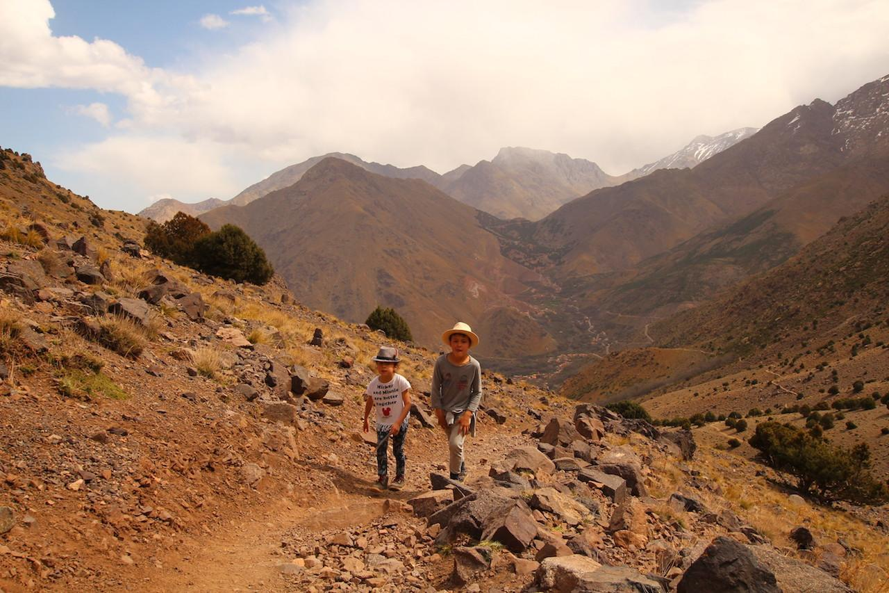 children trekking next to Imlil